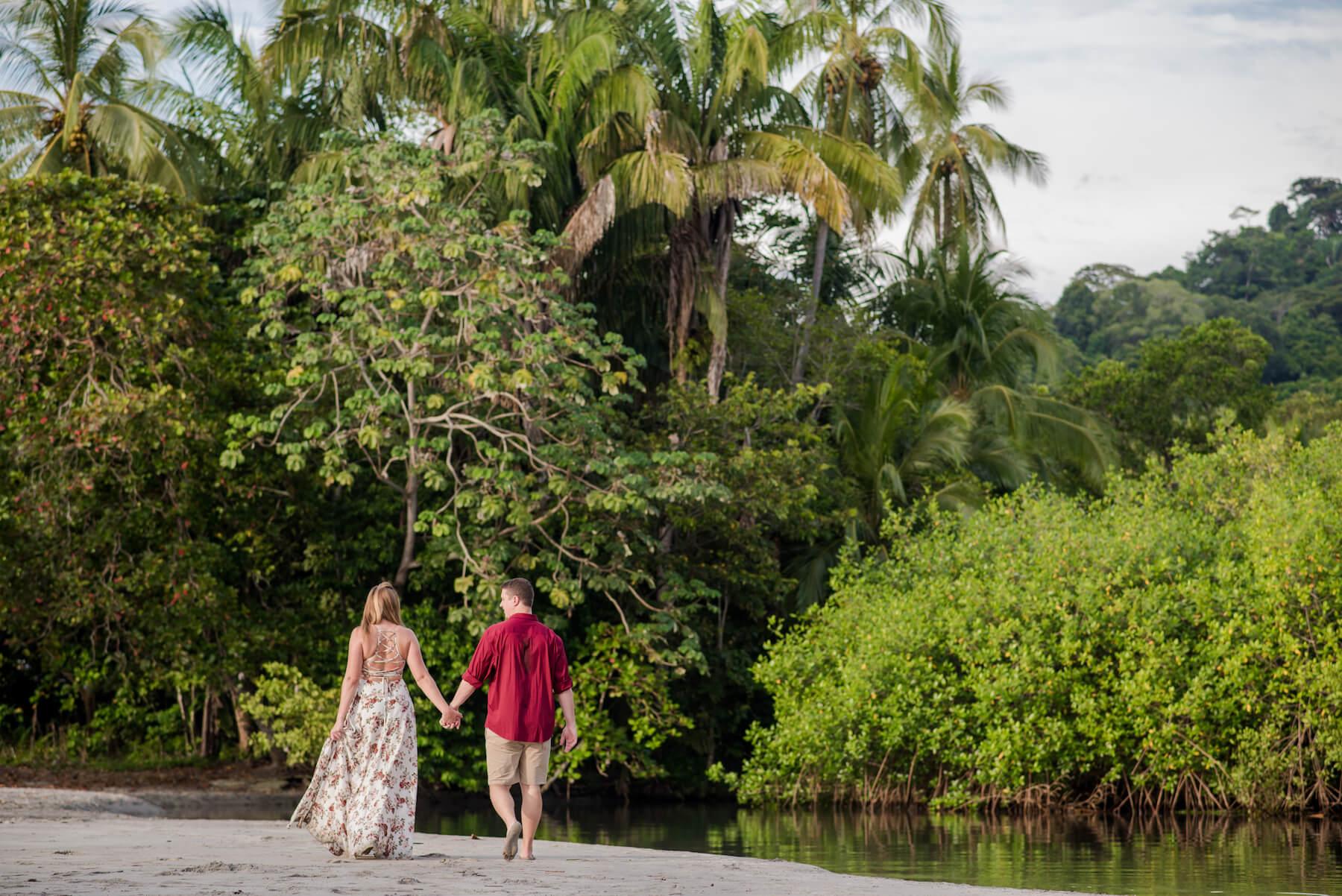 couple walking down the beach in Manuel Antonio, Costa Rica