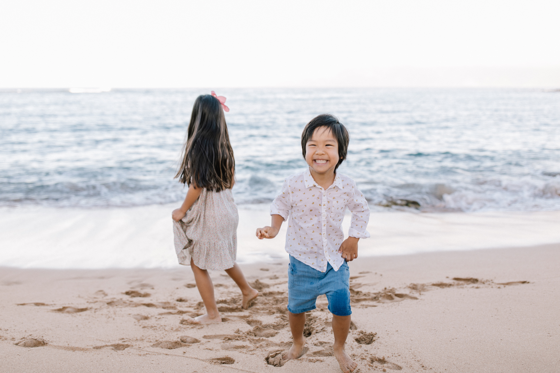 small children, a brother and sister having fun on the beach in Maui, Hawaii