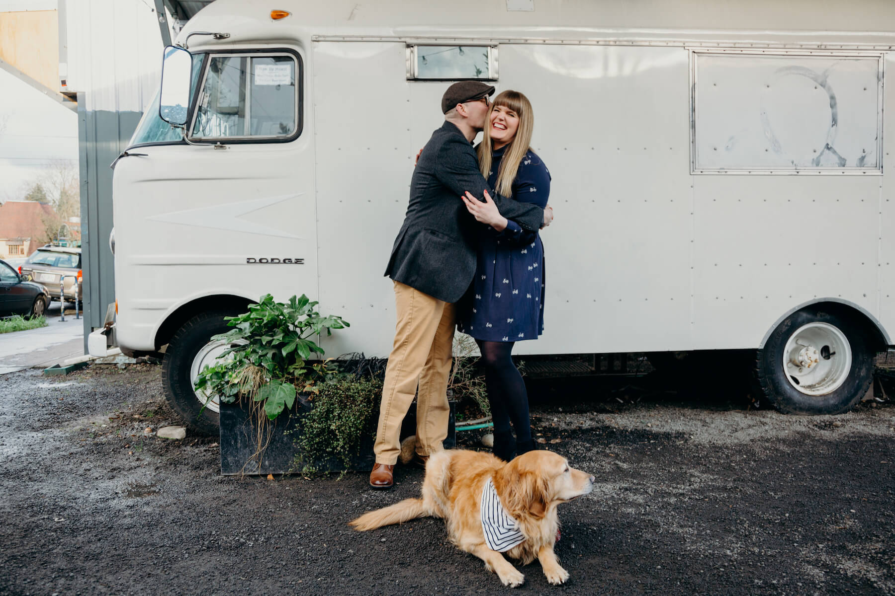 couple with a dog standing in front of a juice truck in portland, Oregon