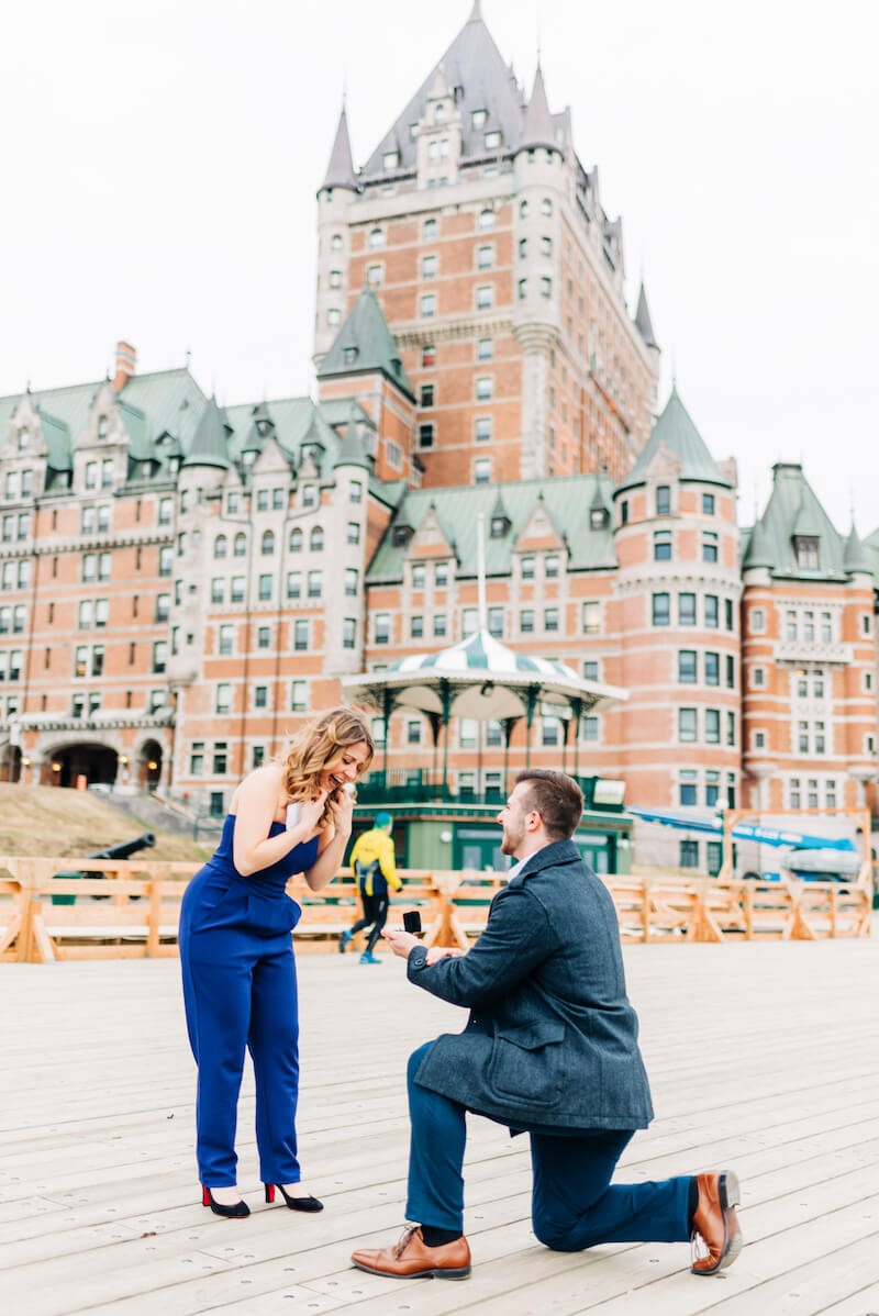 a man is on one knee proposing to a woman in Quebec City, Canada