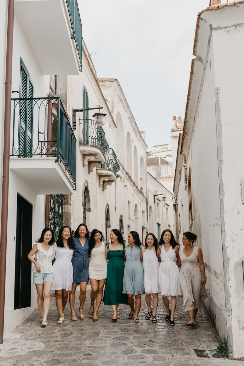 a large group of friends on a girls trip to Amalfi Coast walking through the town of Ravello, Italy