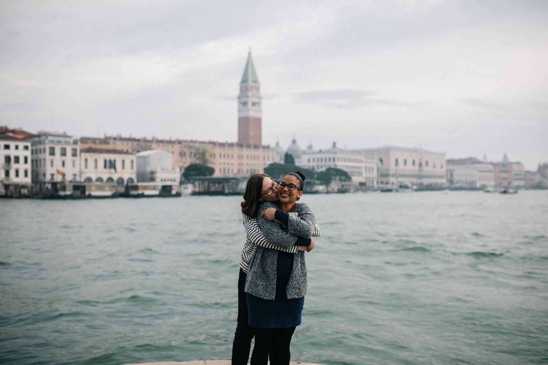 LGBTQ pregnant couple embracing each other in Venice, Italy