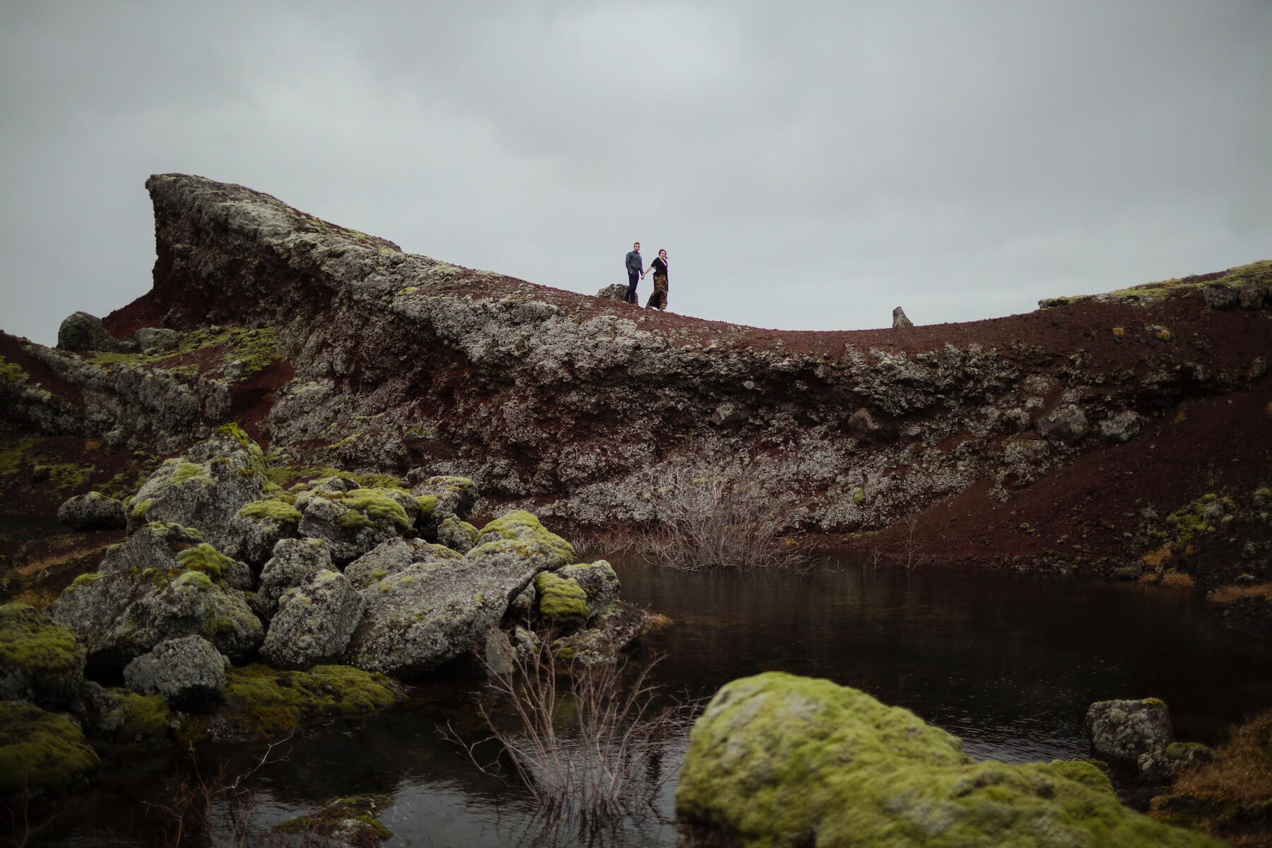 couple walking on a hill in Reykjavik , Iceland