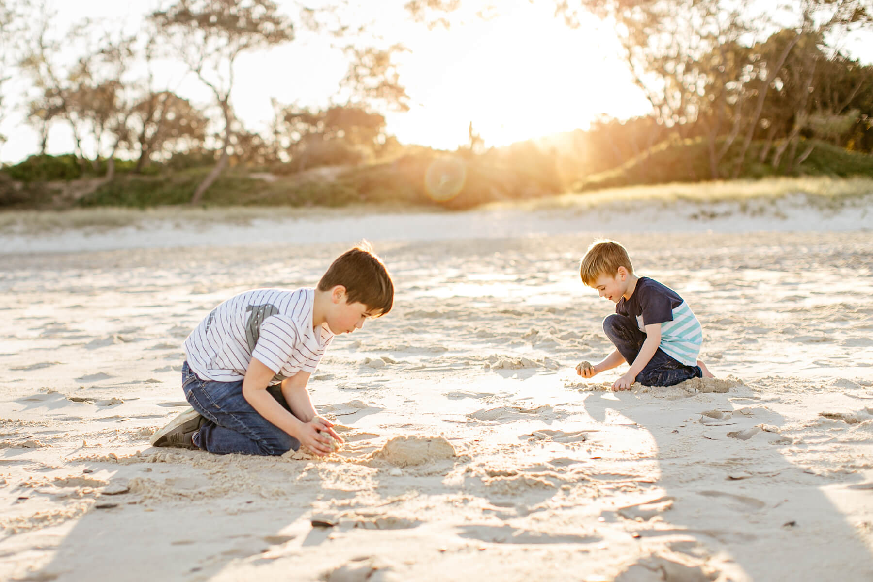 Couple on the beach with kid in Byron Bay