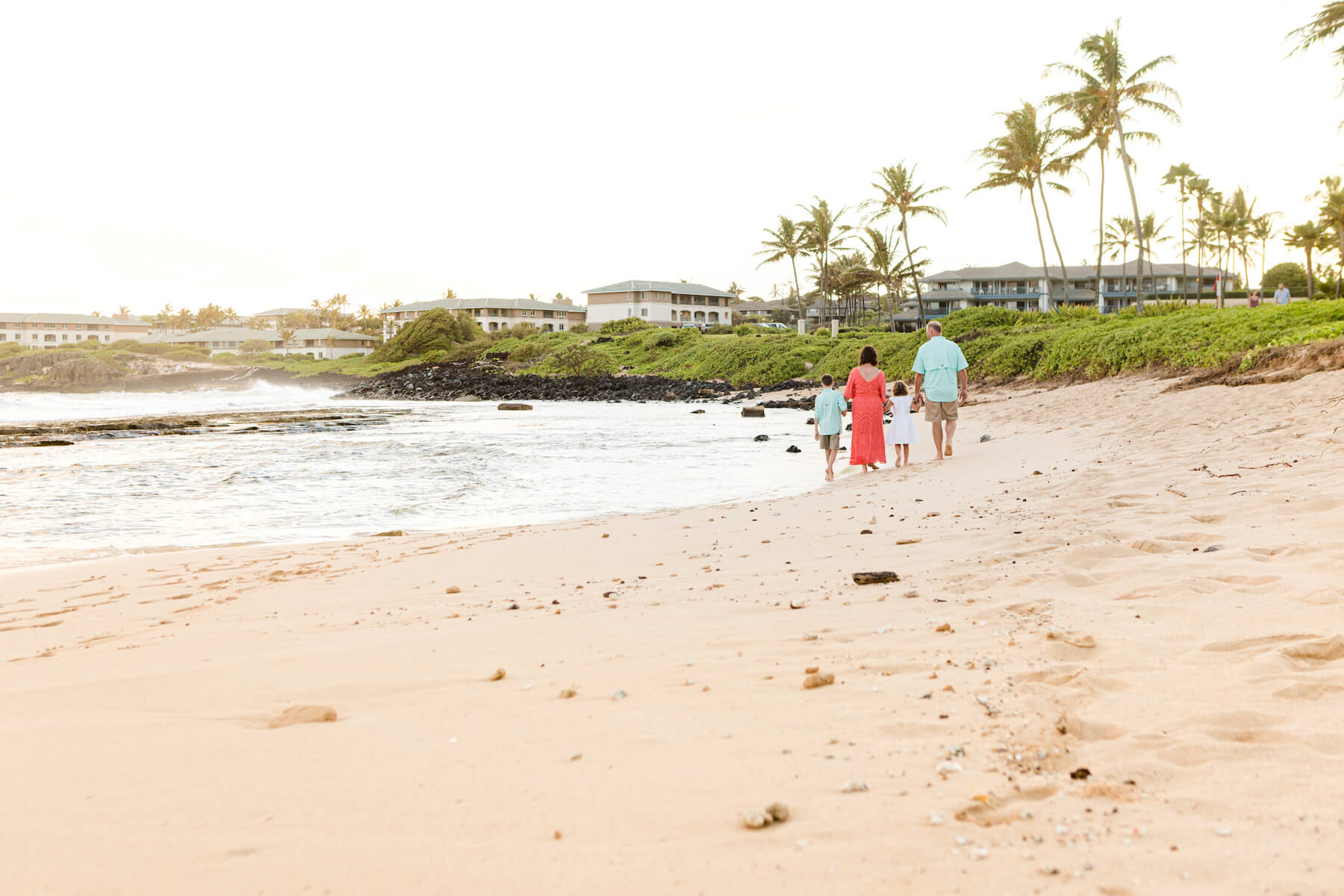 Family walking on the beach in Kauai Hawaii USA