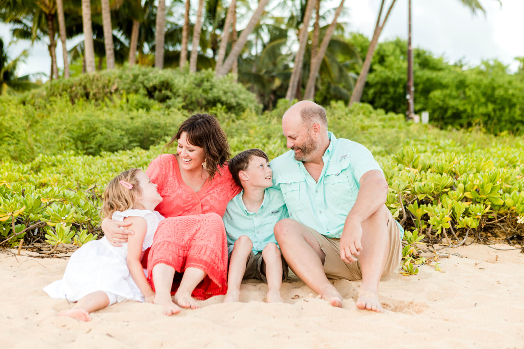 Family on the beach in Kauai Hawaii USA