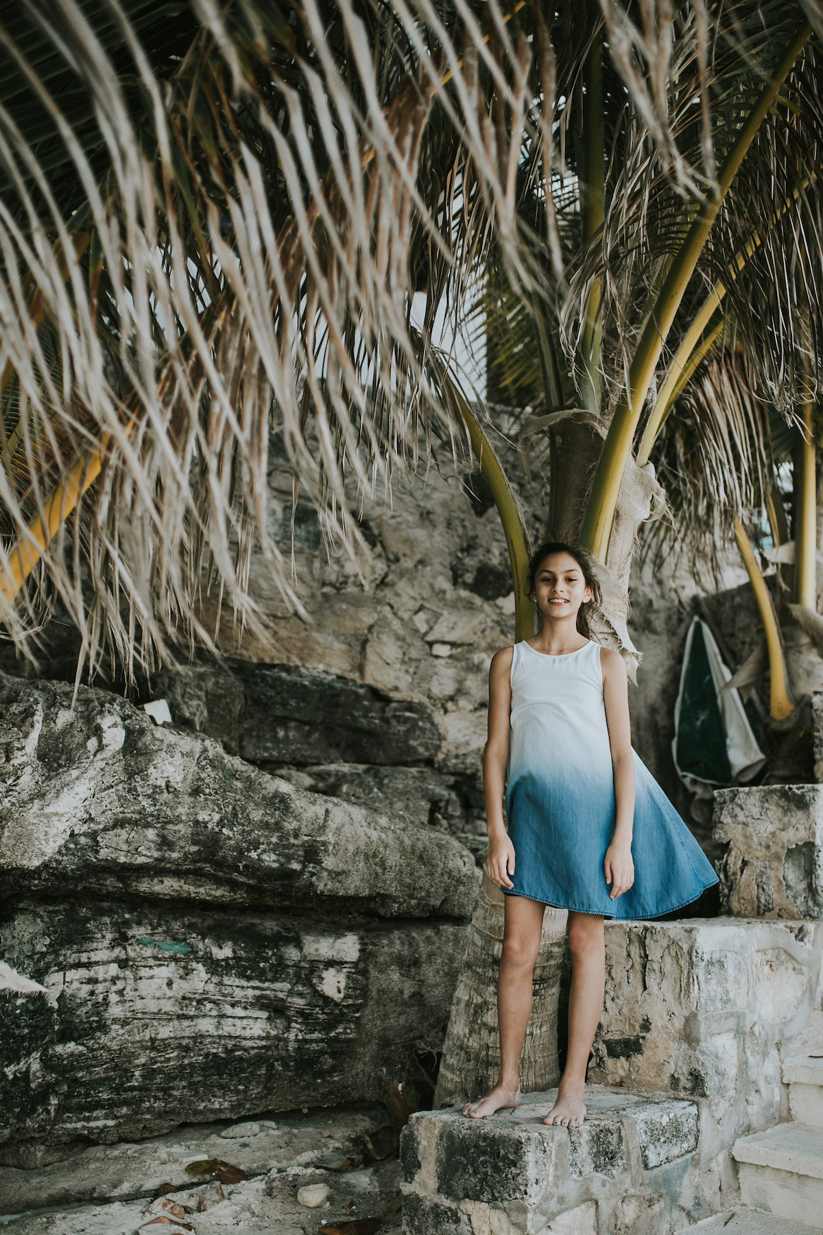 Girl by a palm tree in Cancun Mexico