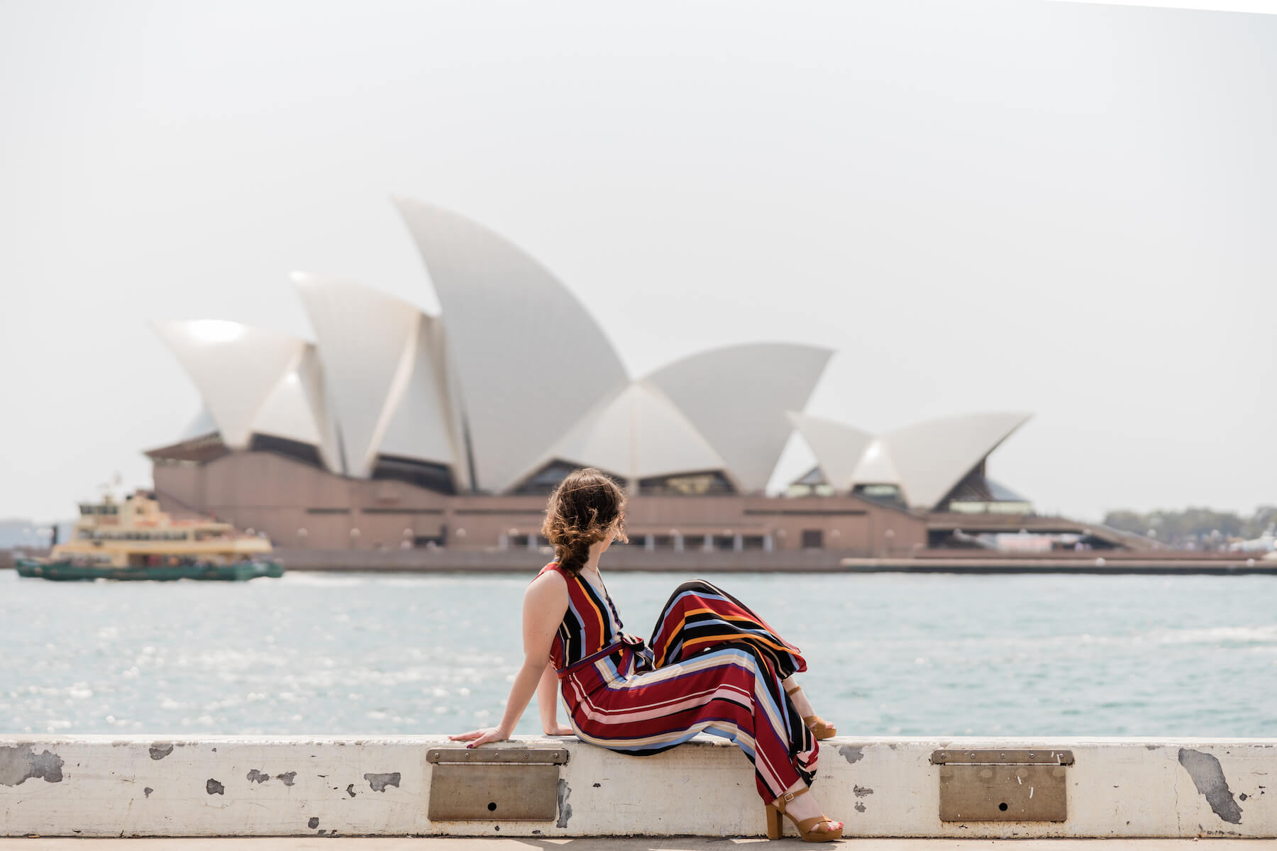 Girl looking at the Sydney Opera House in Australia