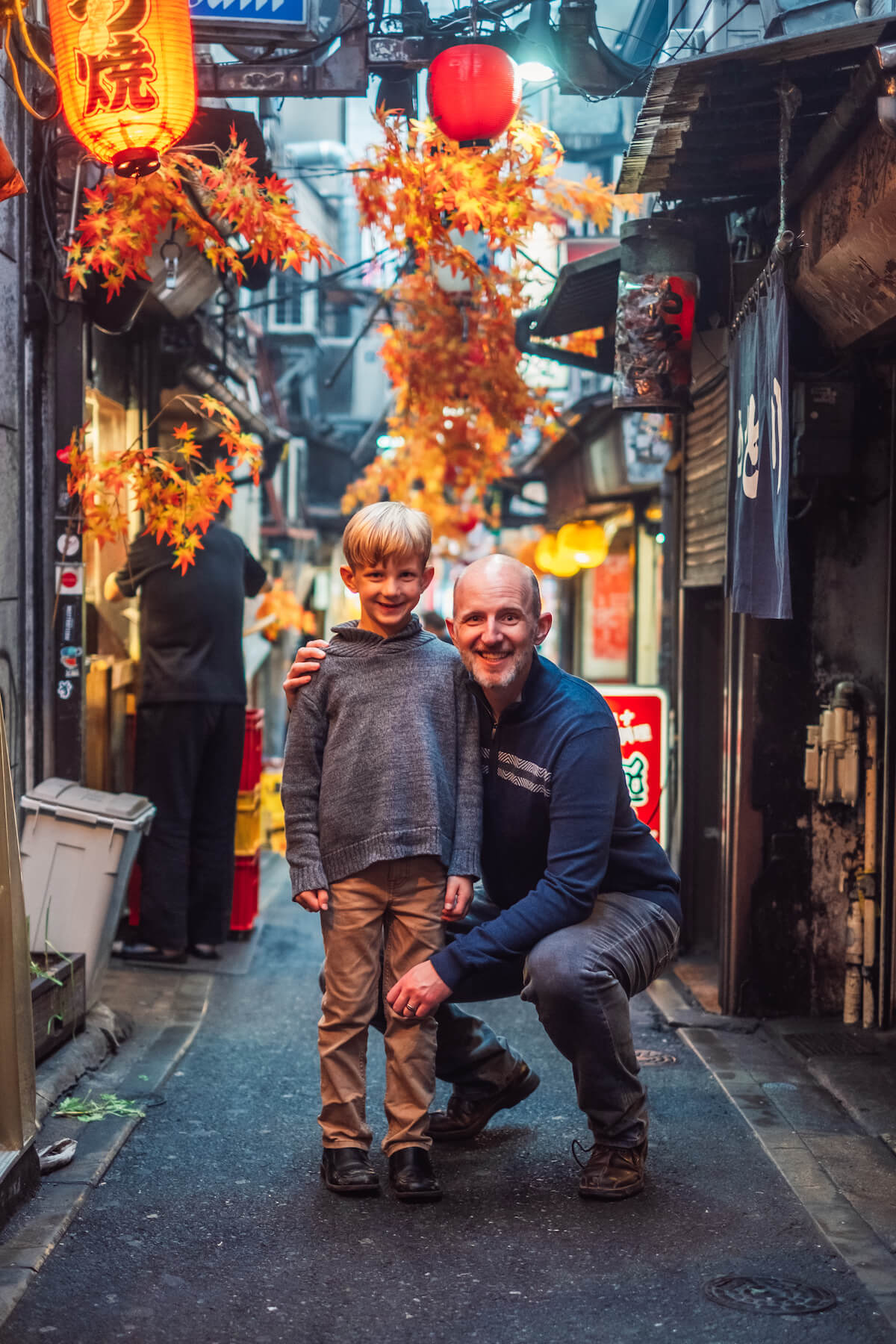 Son and Dad in an ally in Tokyo Japan