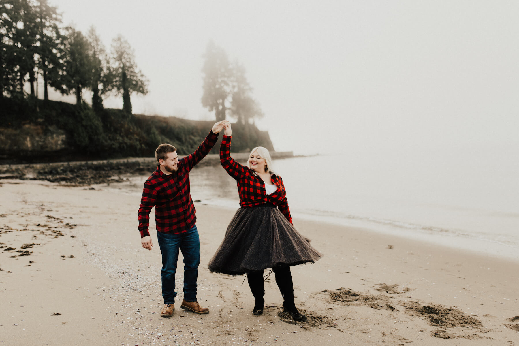 couple dancing on the beach in vancouver canada on a flytographer photo shoot