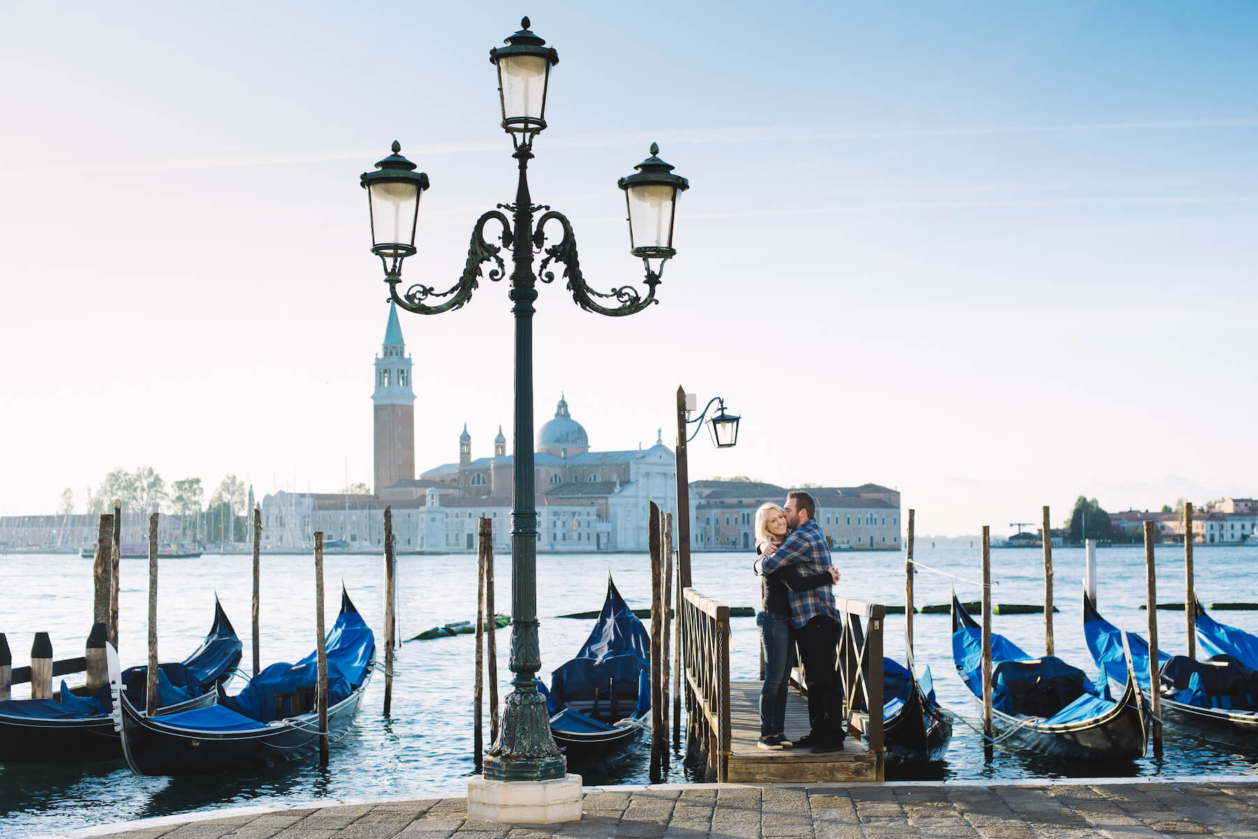 Couple in front of a gondola in Venice Italy
