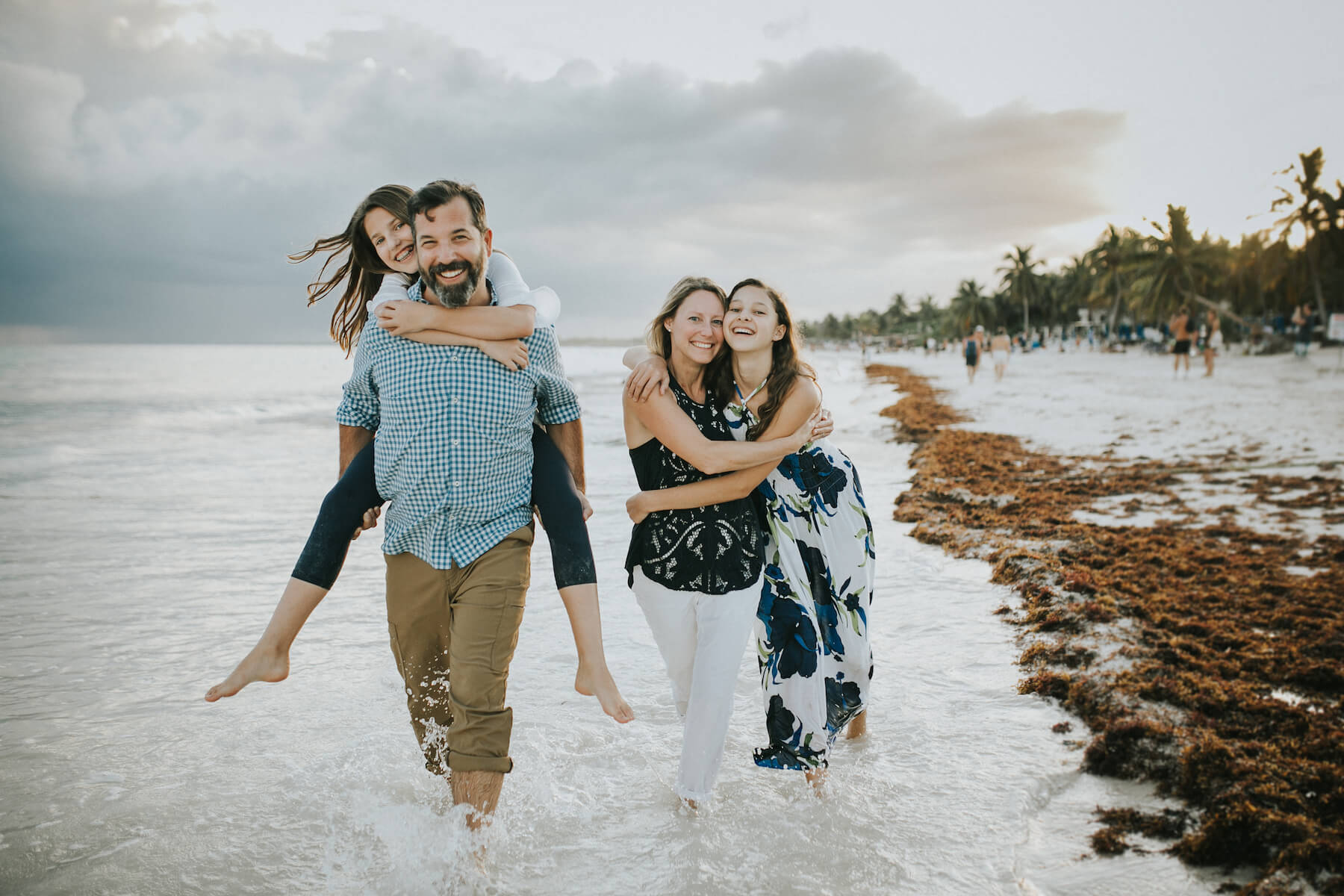 Family in Tulum Mexico laughing with Teenage girls