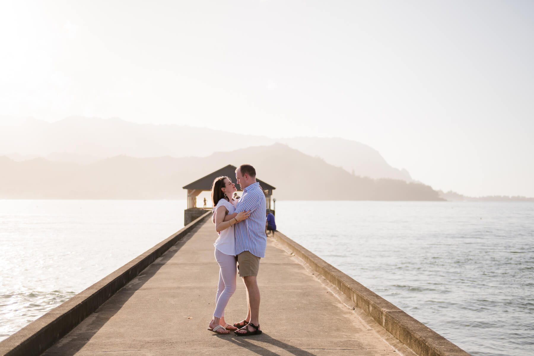couple on a dock in Kauai Hawaii