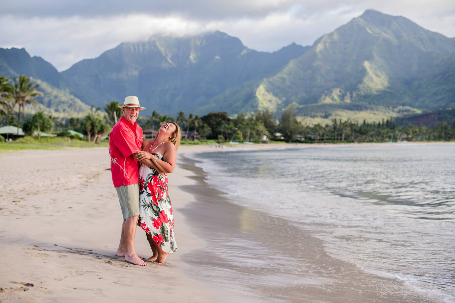 couple on a beach in Kauai Hawaii