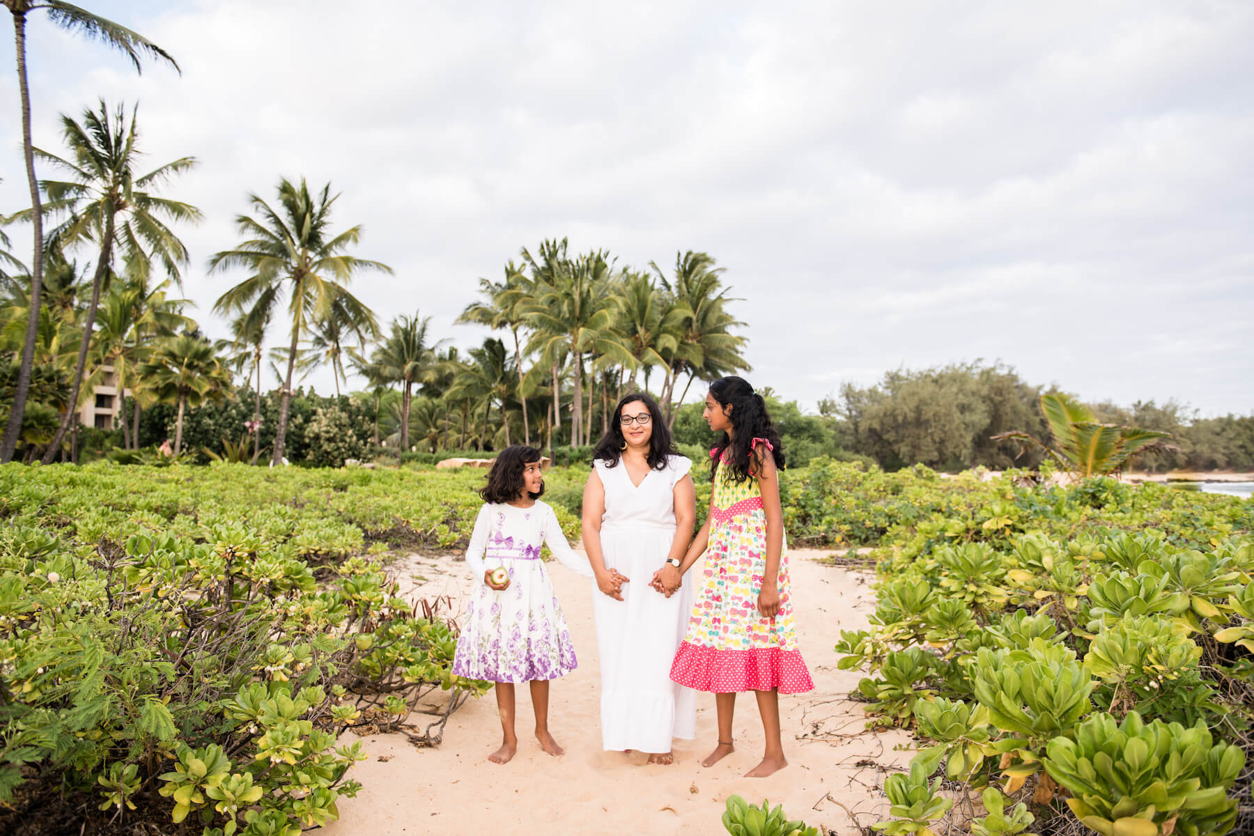 Mother and daughters on a beach in Kauai Hawaii