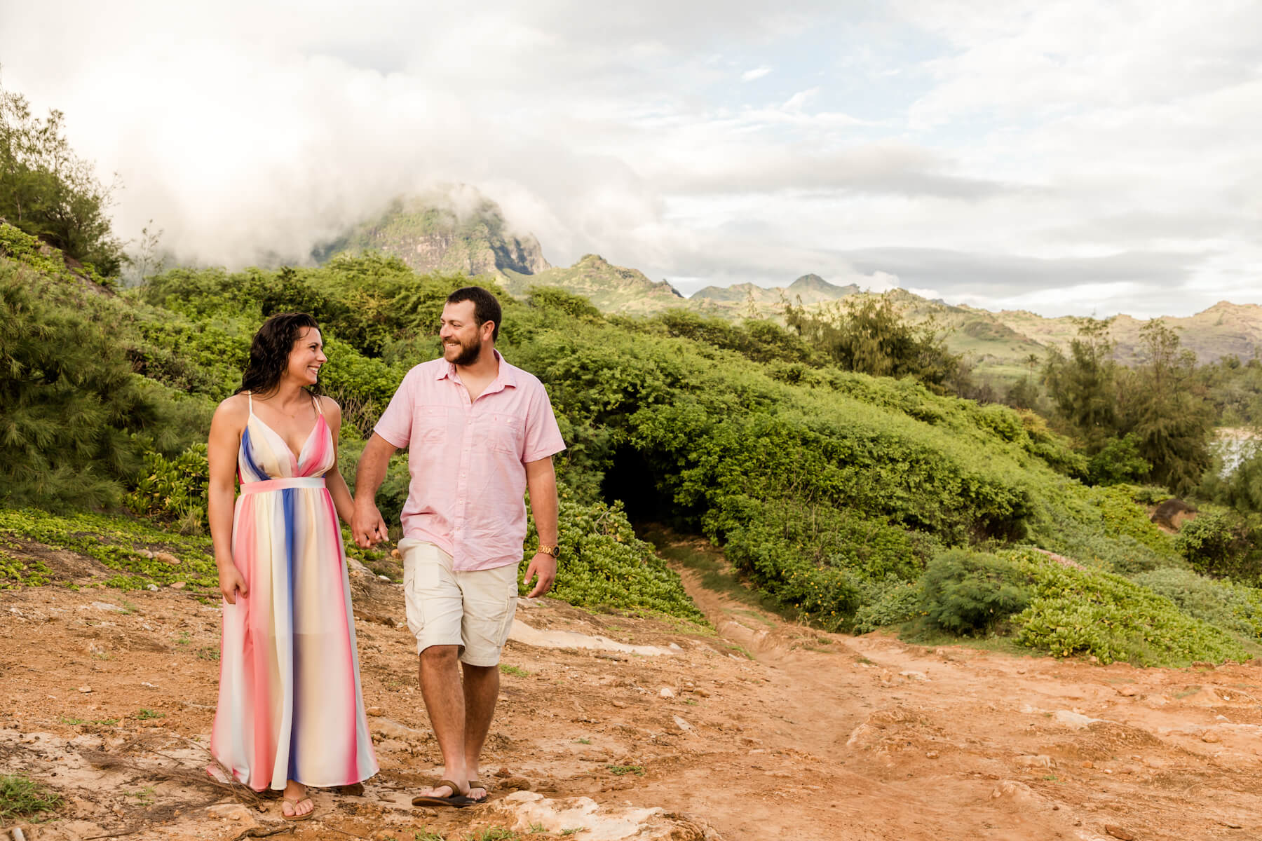 Couple laughing and walking in Kauai Hawaii