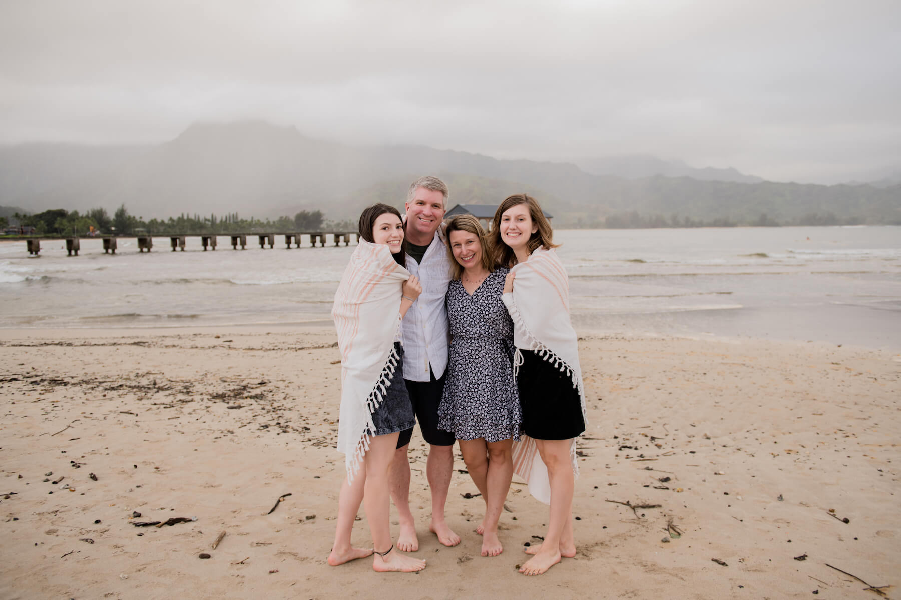 Family on a beach in Kauai Hawaii