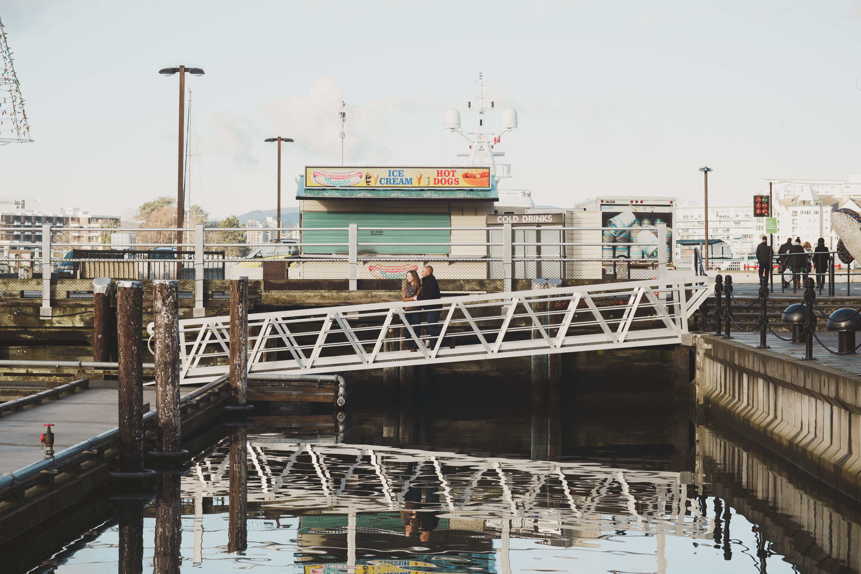 Two people on a fishing dock in Victoria BC