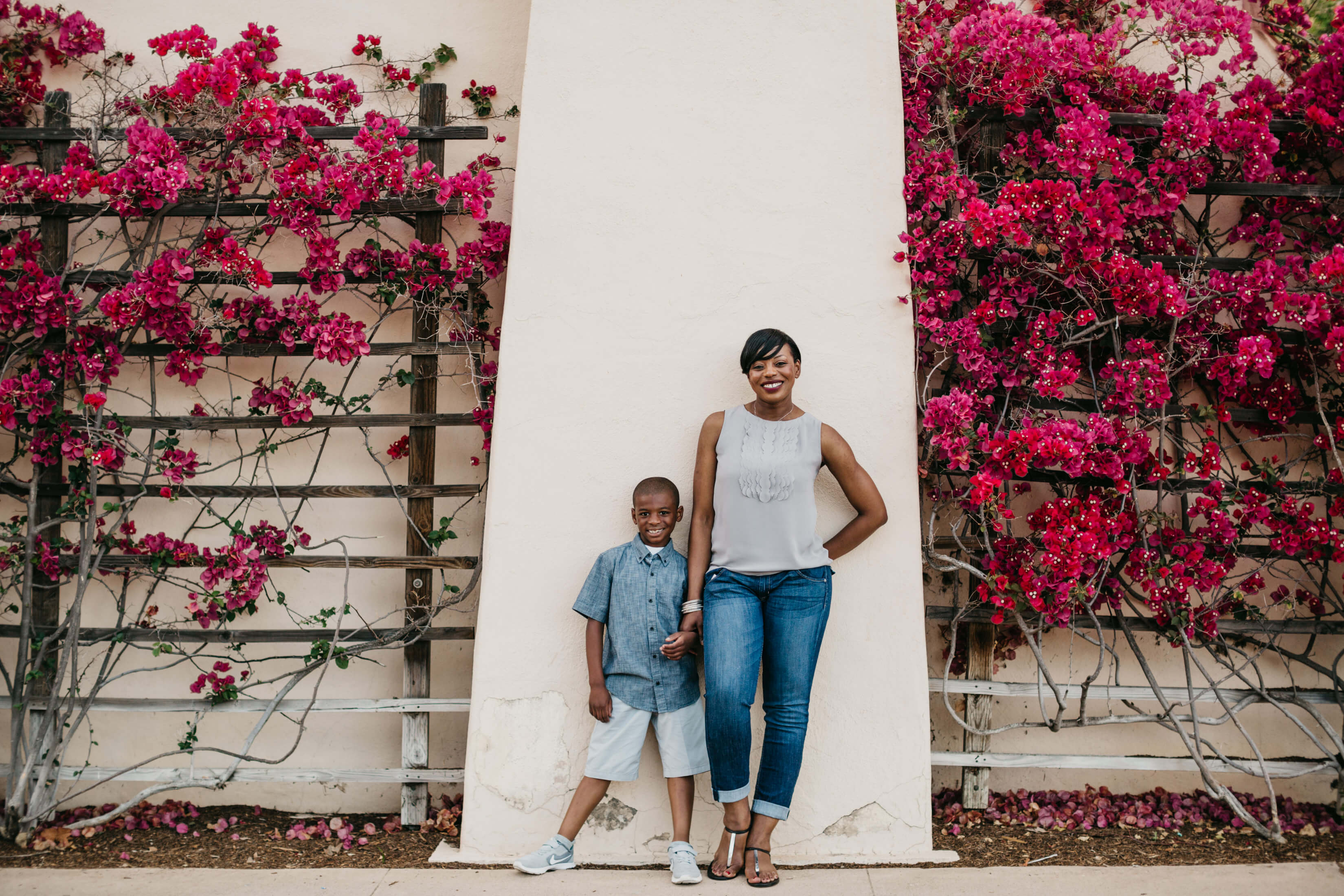 A mother and her young son stand in front of a building in San Diego, California.