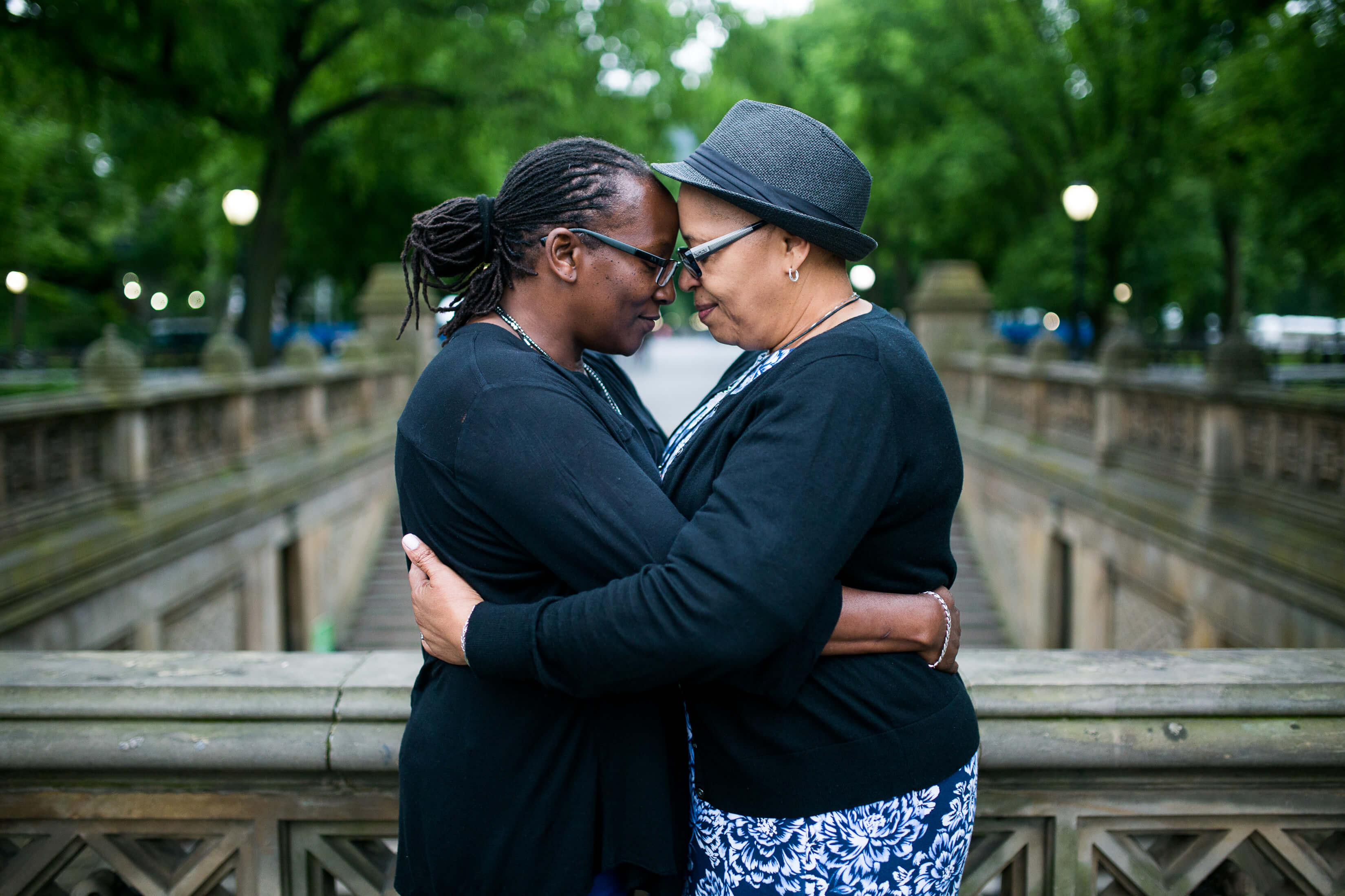 Two lovers embrace in Central Park, New York City, USA.