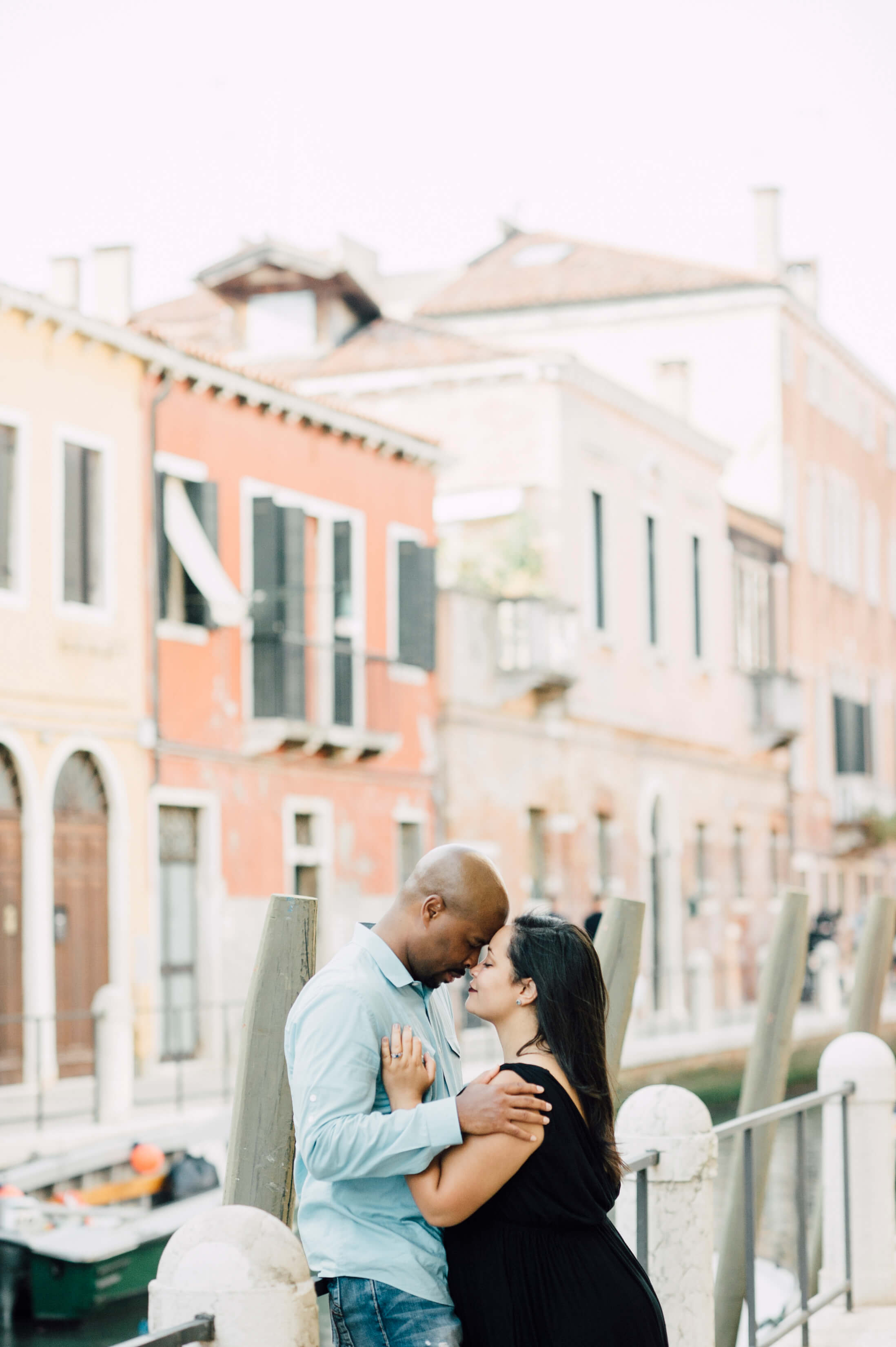 A couple hold each other lovingly on the streets of Venice, Italy.