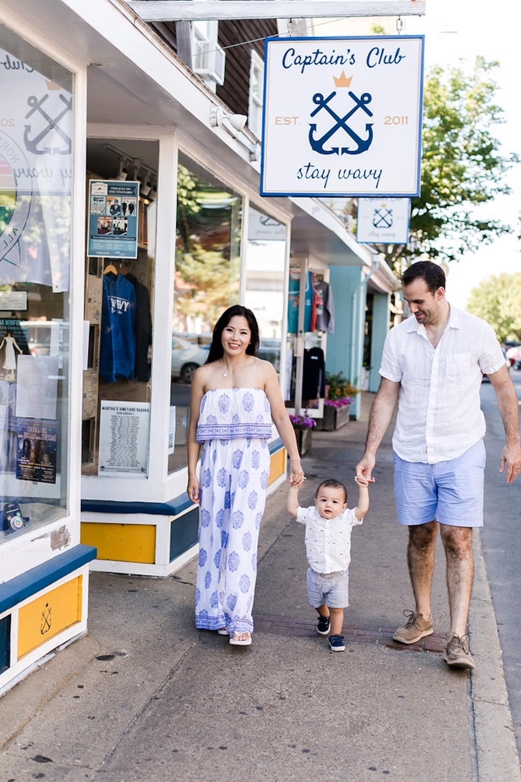 A happy family walks down Main Street in Martha's Vineyard, Massachusetts, USA.