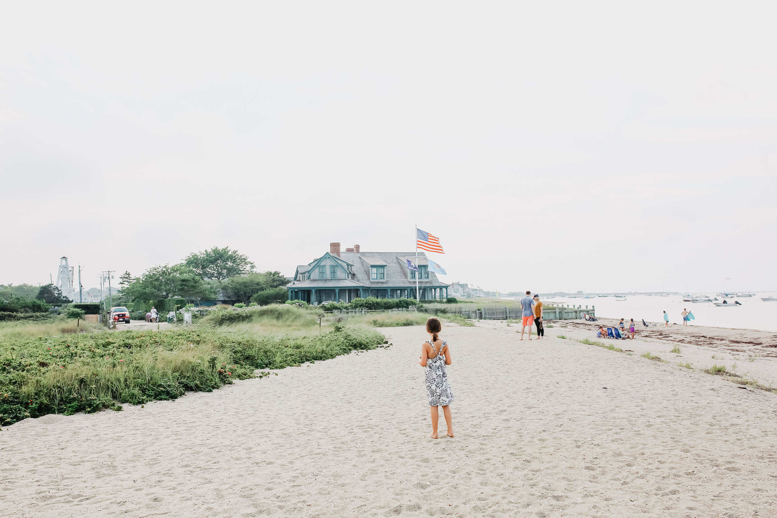 A girl stands on the beach in Nantucket, Massachusetts, USA.