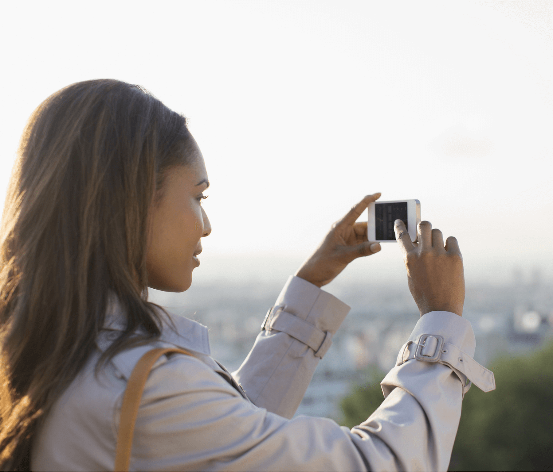 Woman taking photo with iPhone