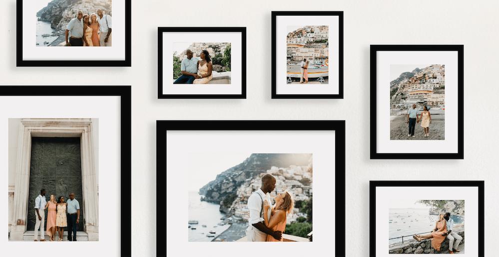 Travel photos framed on a wall