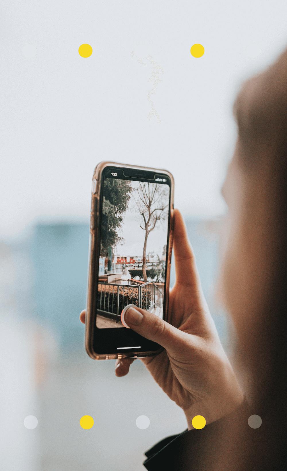 Woman taking iPhone photo in Paris
