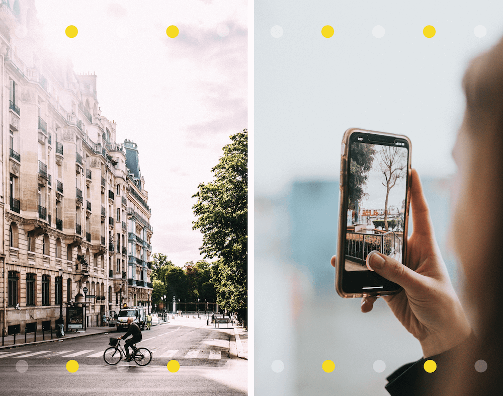 Cyclist in Paris and hand holding iPhone to take a photo