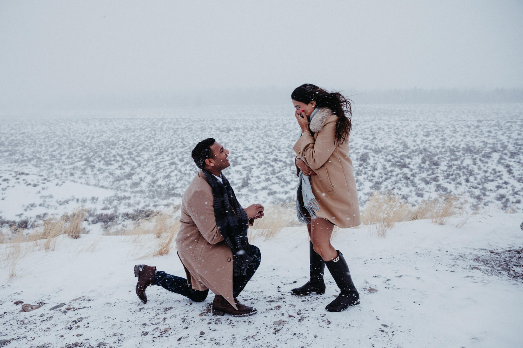 man is proposing to a woman and is on one knee in Chicago, USA