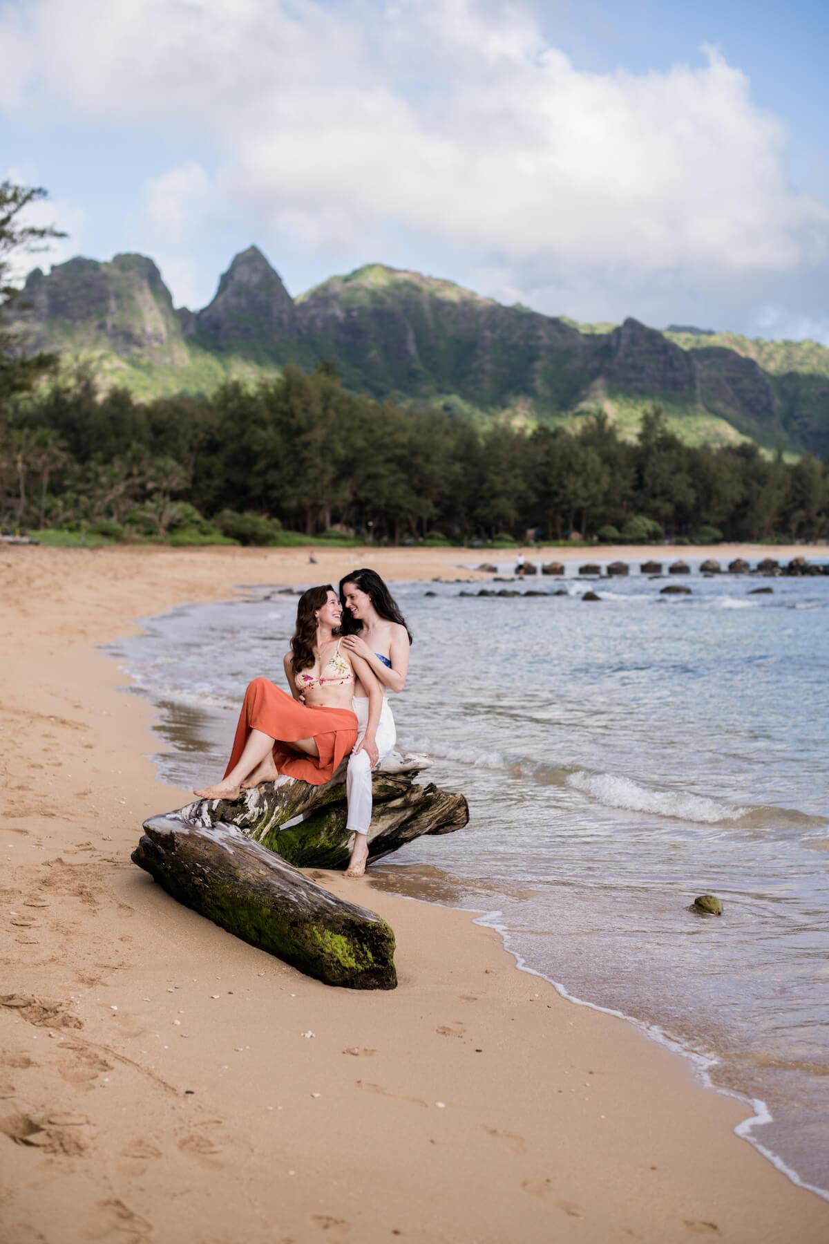 Lesbian couple on honeymoon in hawaii, travel vacation photoshoot