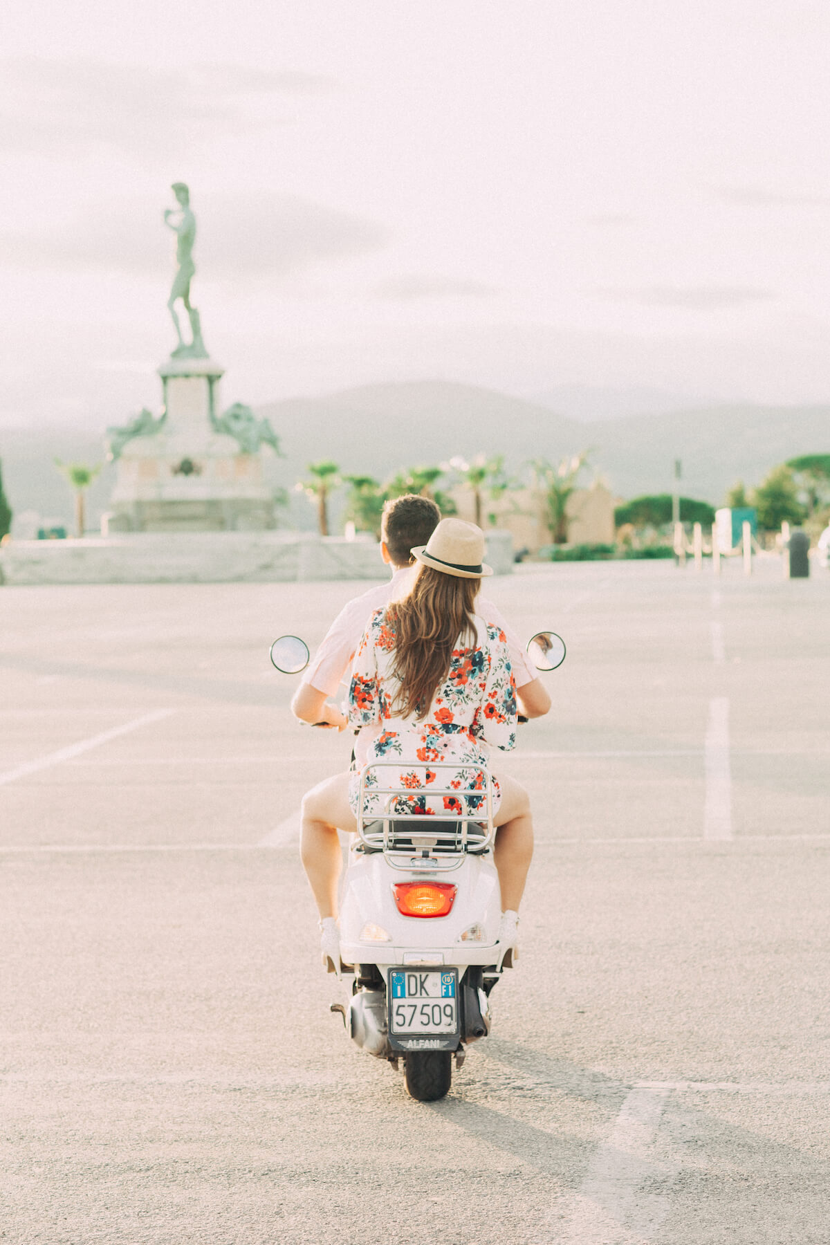 Couple on honeymoon on scooter in Florence Italy in Europe