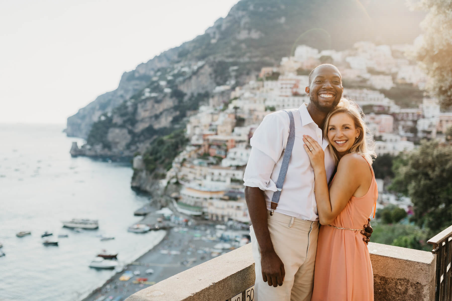 couple posing for their Flytographer photo shoot in Positano on the Amalfi Coast in Italy