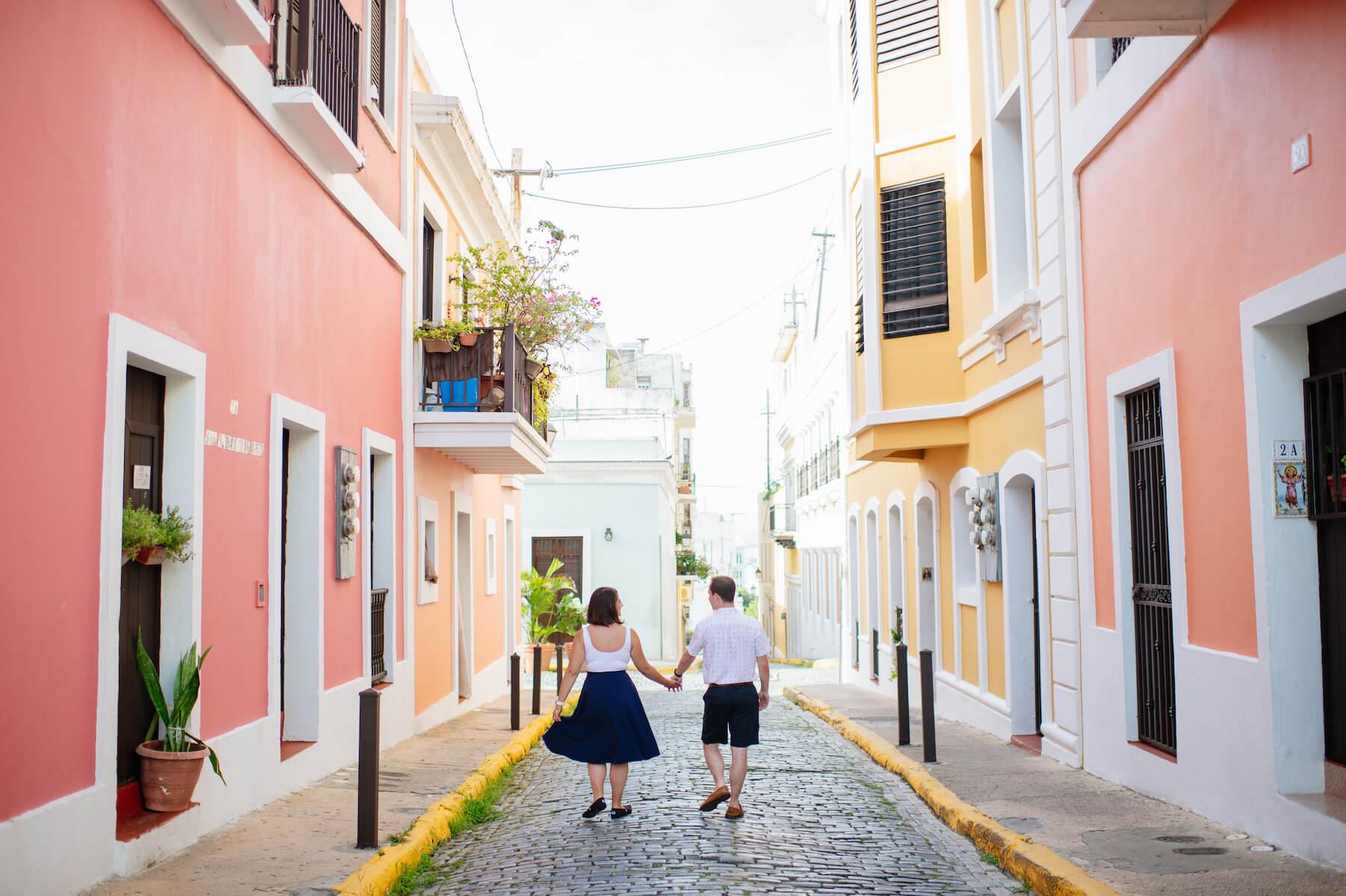 couple walking on street in San Juan Puerto Rico on a Flytographer photo shoot