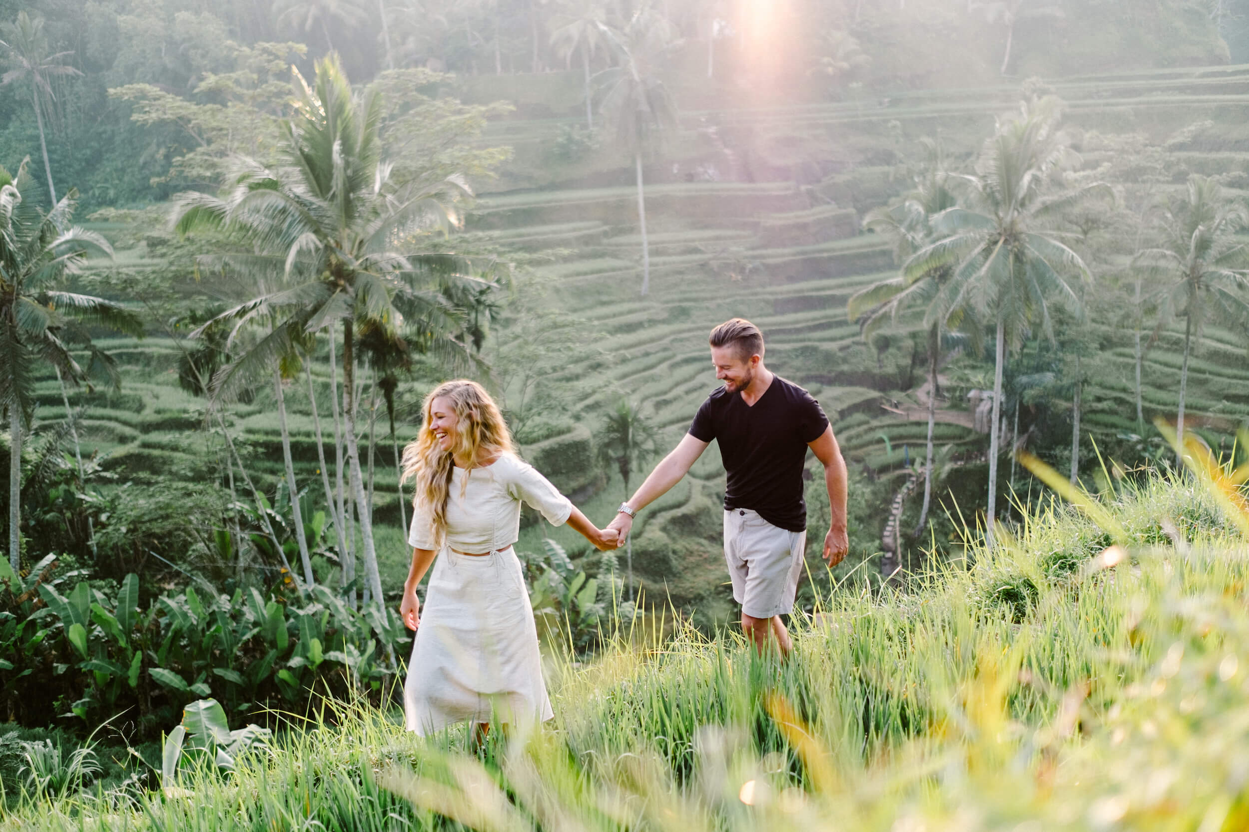 couple walking in rice terrace in Bali captured by Flytographer