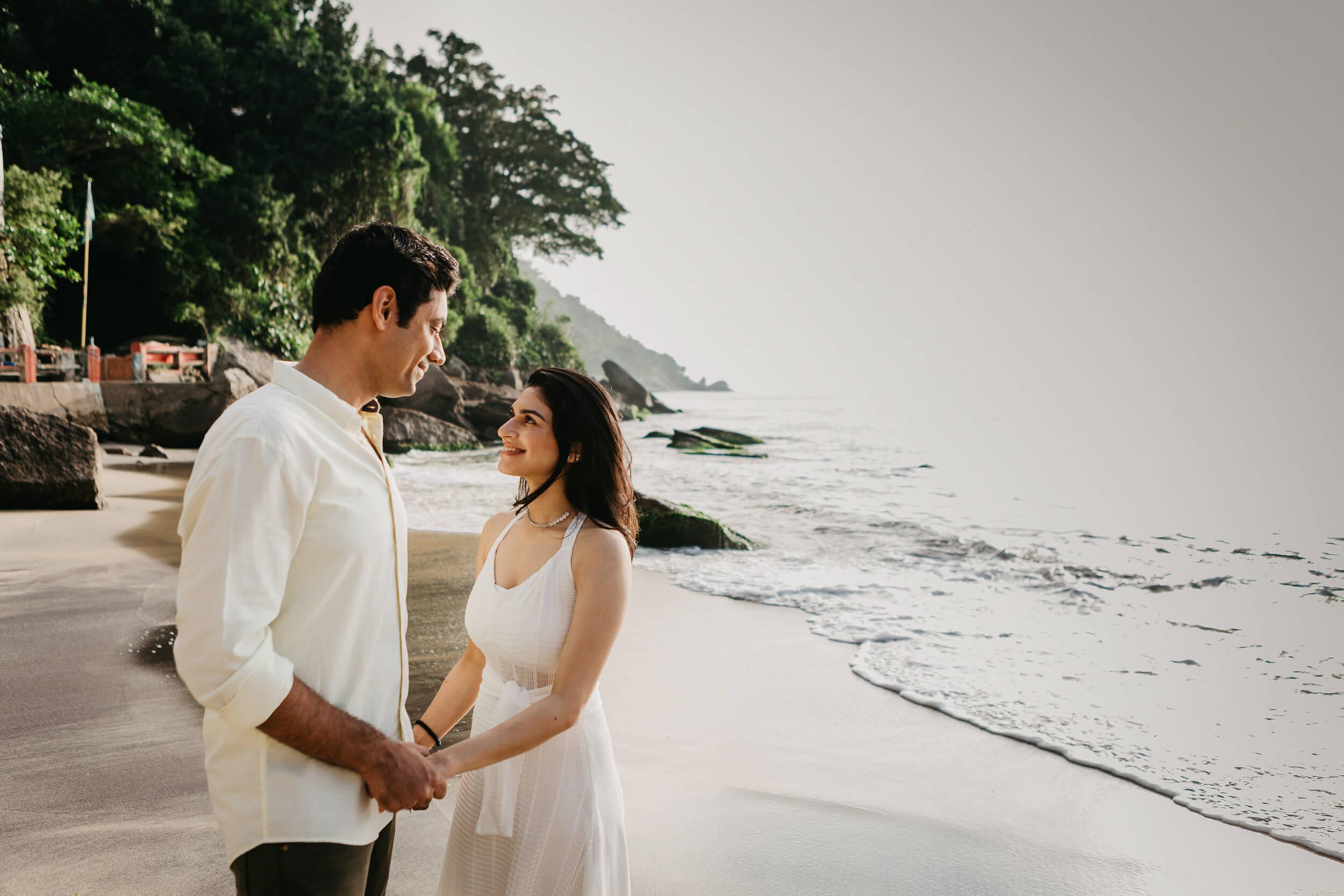 couple on the beach in rio de janeiro Brazil on a Flytographer photo shoot