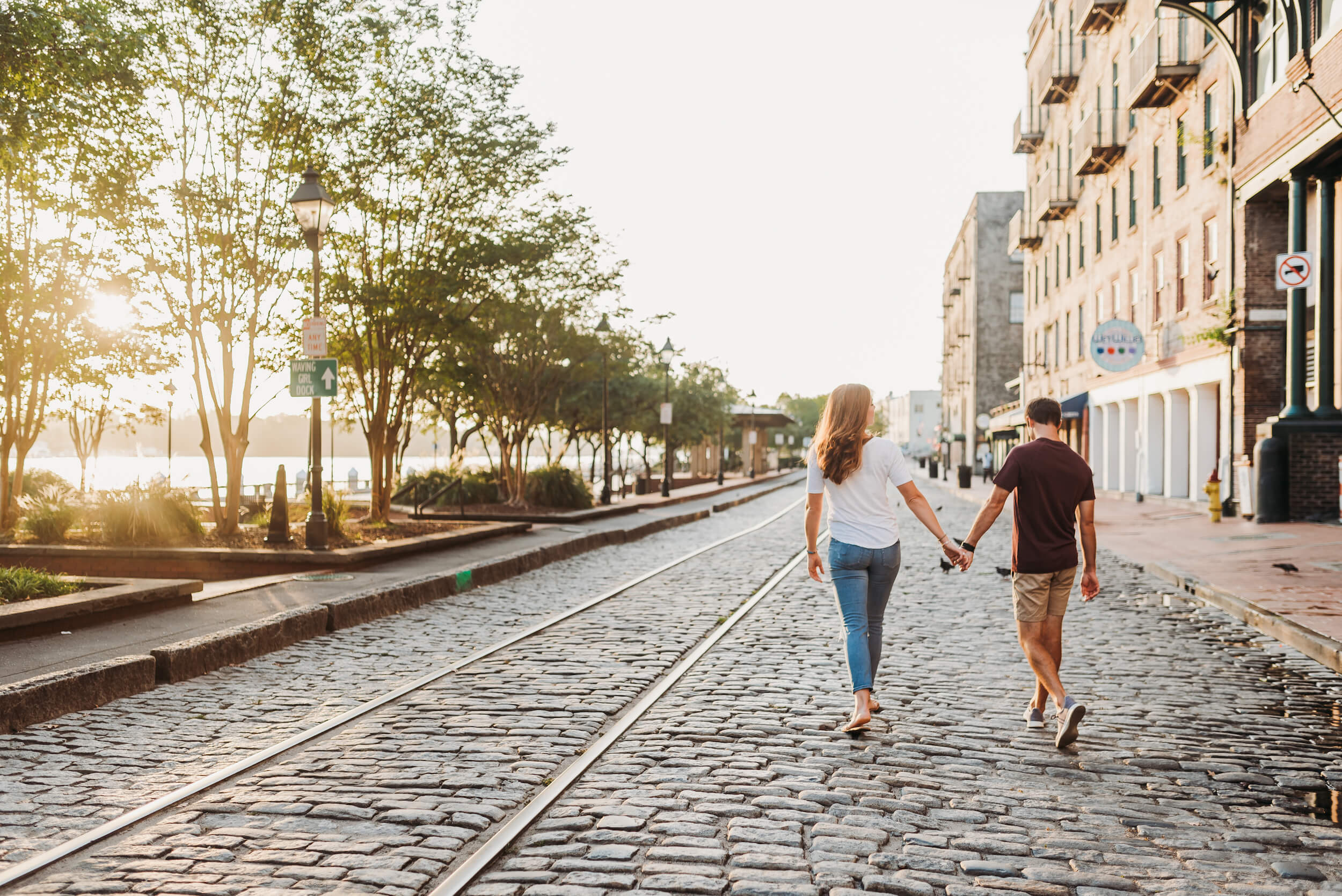 couple walking down the street in Savannah on a hometown Flytographer Photo shoot