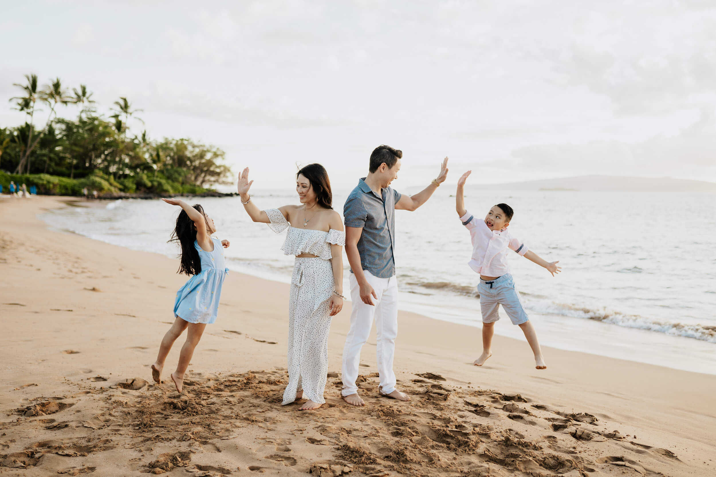 family on the beach in Maui on a Flytographer Photo shoot
