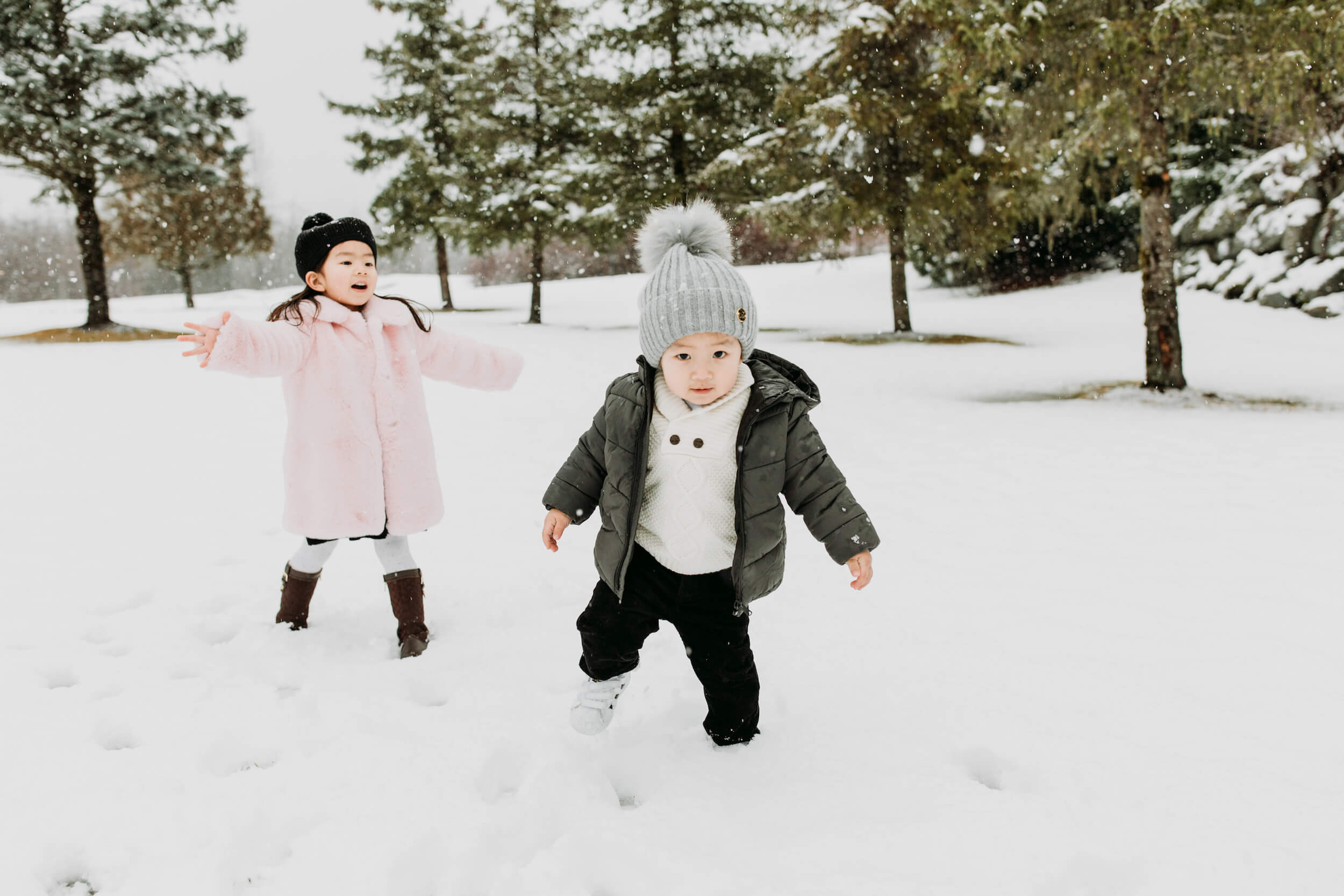 Photo of kids playing in the snow in Whistler Canada on a family trip captured by Flytographer
