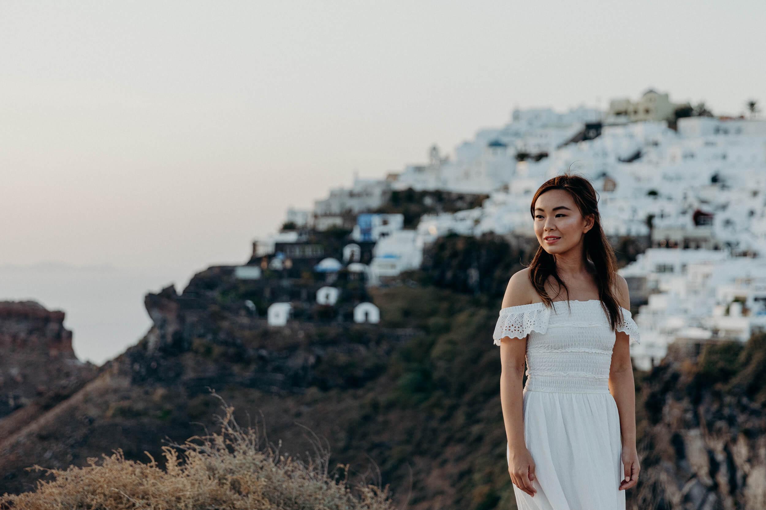 solo traveller in Santorini captured by flytographer