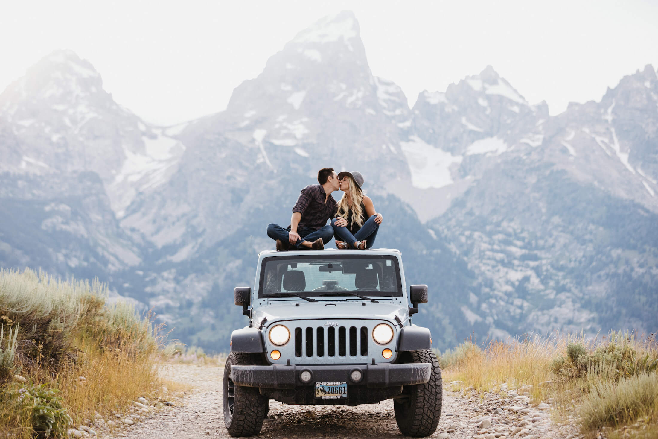 couple sitting on top of a jeep kissing in Jackson Hole, Wyoming