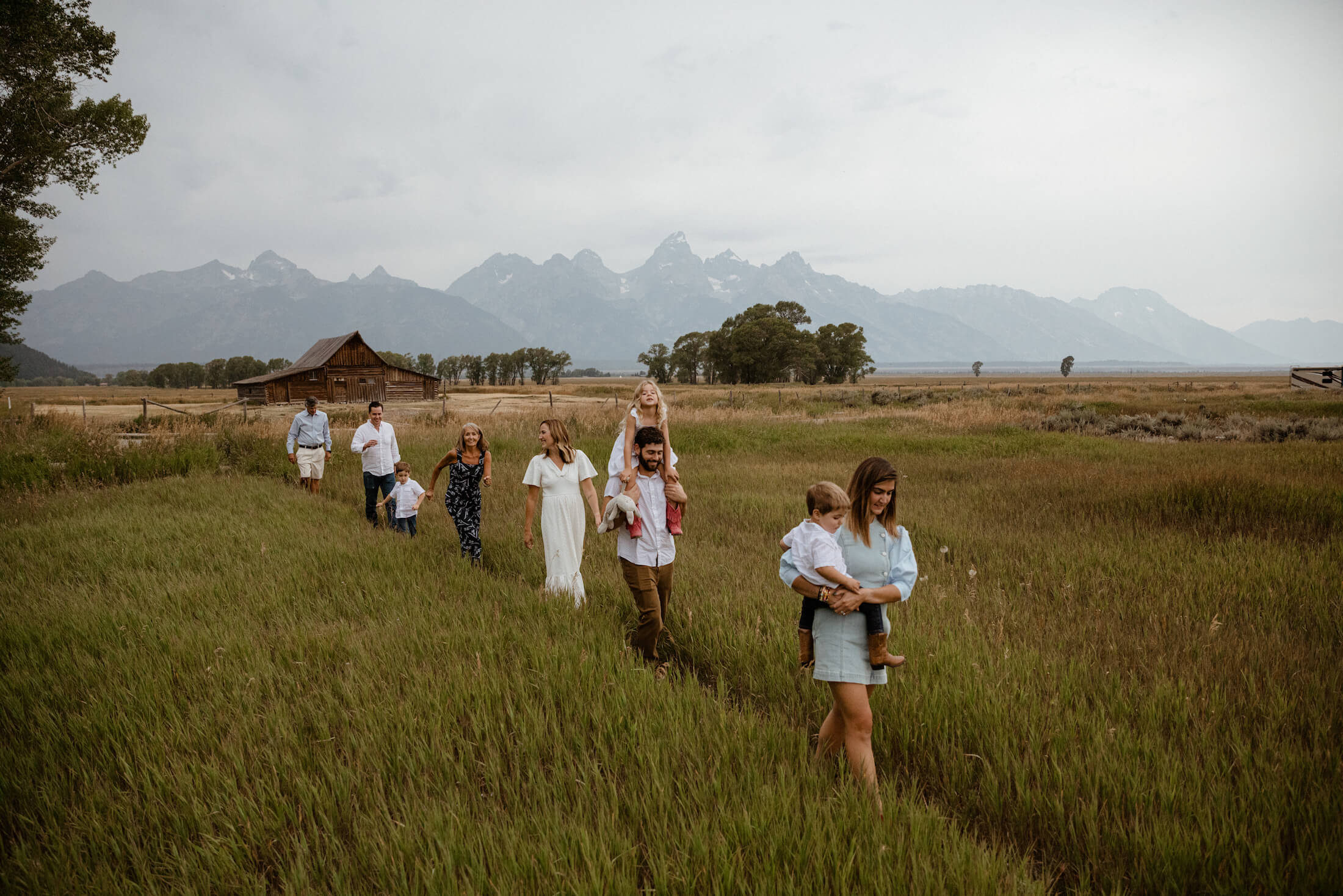 family walking in a field in Jackson Hole, Wyoming