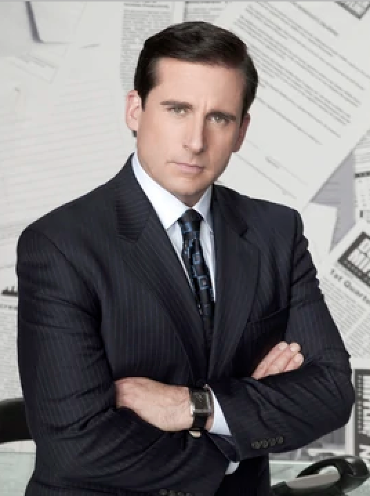 Picture of a man dressed in a suit from the t.v show the office