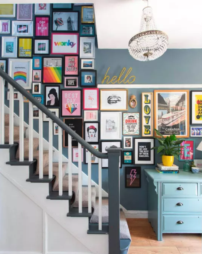 Gallery wall in a colourful stairwell.
