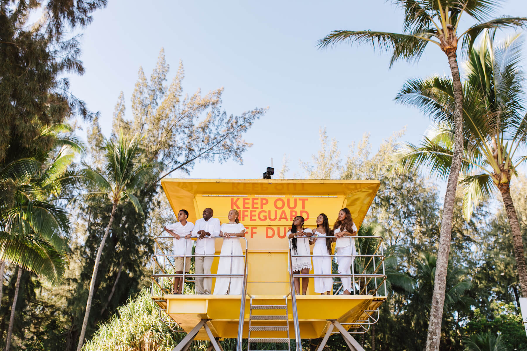 Family of 6 standing on a lifeguard tower in Miami, Florida