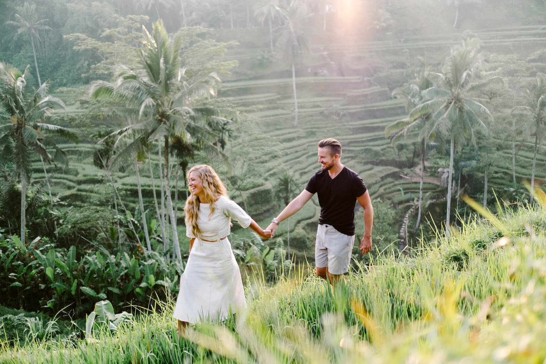 Couple in the Tegalalang Rice Terrace in Bali, Indonesia captured on a Flytographer photo shoot.