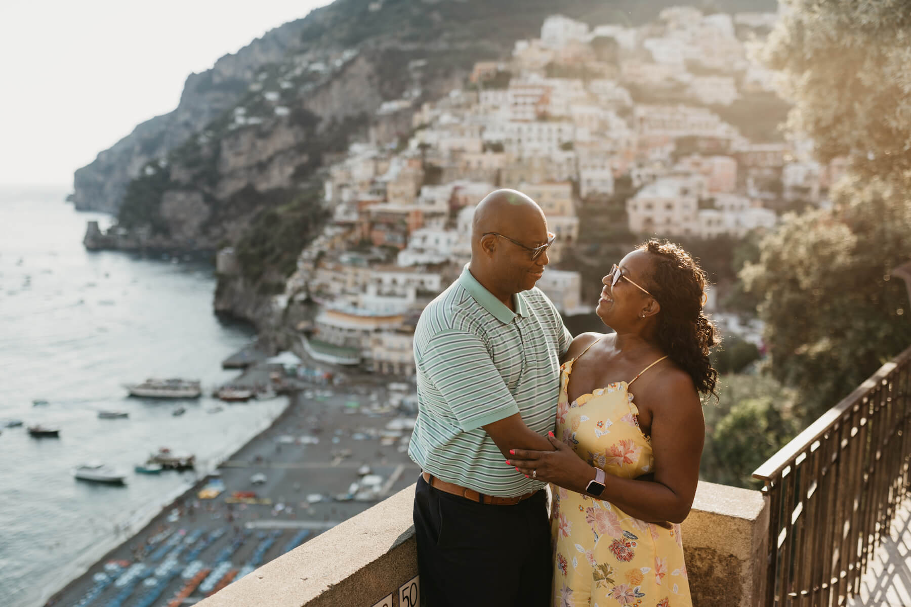 Couple hugging on their family trip to the Amalfi Coast photographed by Flytographer