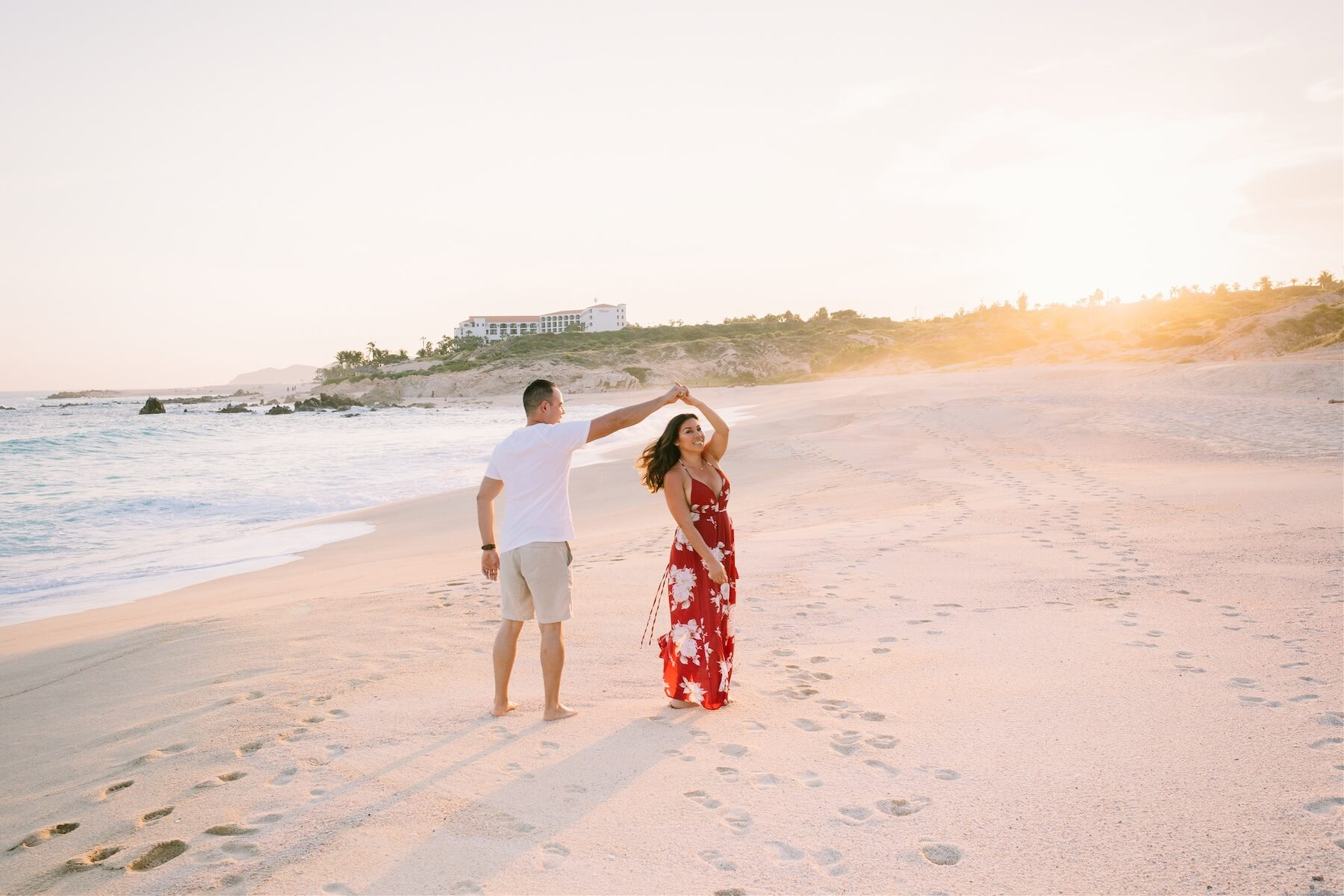 Couple walking on the beach in Cabo San Lucas on a Flytographer photoshoot